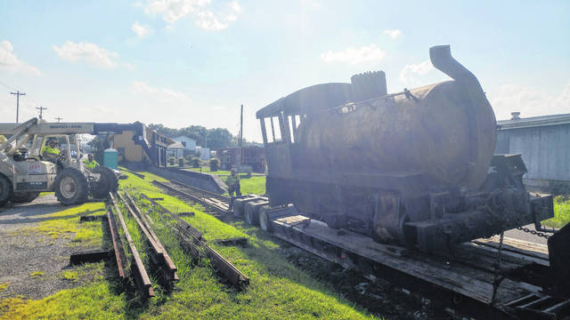 The Gallipolis Railroad Freight Station Museum loaded a 1945 Porter steam engine Monday onto its outside rails after acquiring it from the nearby West Virginia State Farm Museum. According to Museum Board Vice-President Jerry Davis, the engine did not have a fire box and was filled with steam. This allowed it to operate in areas where an open flame may be too dangerous for other steam engines. Museum board members say they anticipate to acquire the farm museum's boxcar and caboose as well in the near future. Red's Auto assisted with the endeavor.