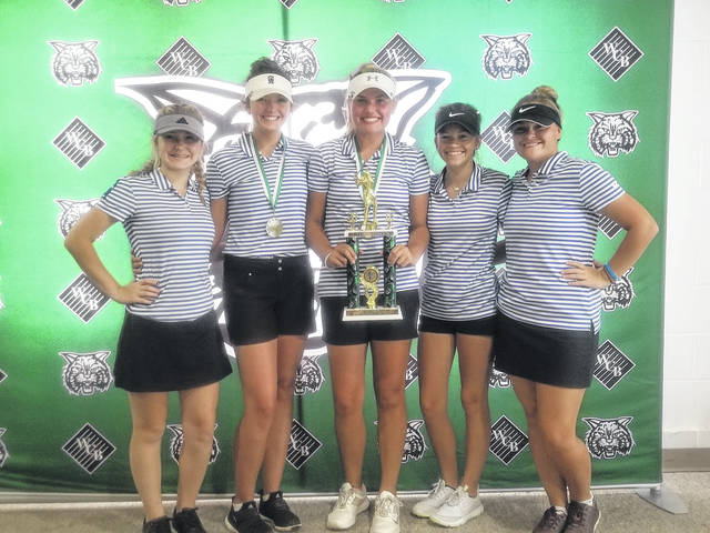 Members of the Gallia Academy girls golf team accept the championship trophy after the 2018 Waterford Invitational on Wednesday at Lakeside Golf Course.