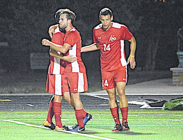 Rio Grande's Eduardo Zurita is congratulated by teammates after his second half goal in Friday night's 3-0 win at Saint Xavier University.