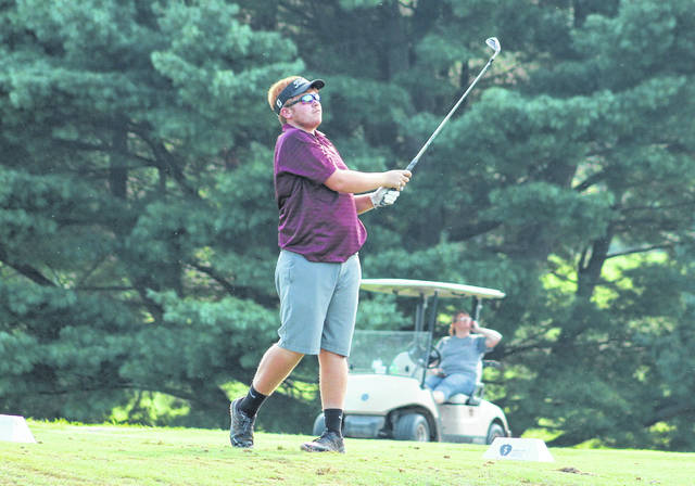 Meigs senior Wyatt Nicholson watches a tee shot on the 12th hole during Monday's TVC Ohio golf match at Franklin Valley Golf Course in Jackson, Ohio.