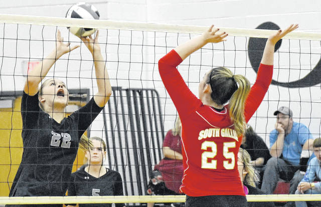 RVHS sophomore Hannah Jacks (22) attempts to volley the ball beyond a block attempt by South Gallia junior Christine Griffith (25) during the Lady Raiders' win on Thursday night in Mercerville, Ohio. (Scott Jones|OVP Sports)