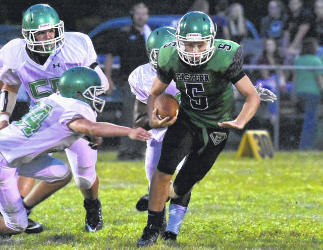 EHS senior Isaiah Fish (5) attempts to evade a tackle during Friday night's 35-0 setback to Huntington Ross in Tuppers Plains, Ohio.