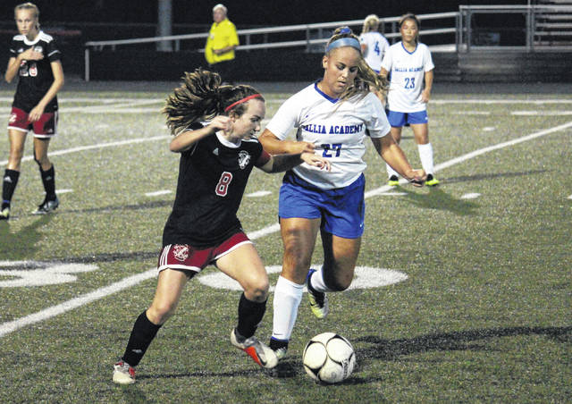 Gallia Academy senior Katie Carpenter (27) battles the ball away from Point Pleasant senior Lexi Watkins-Lovejoy, during the Lady Knights' 4-0 victory on Tuesday in Point Pleasant, W.Va.