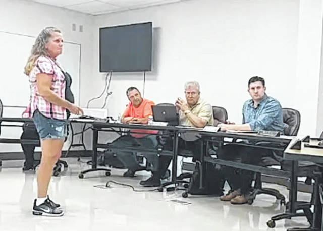 Pamela Hopkins asks the Gallipolis City Commission to pay for her damaged vehicle after a pole reportedly fell on it.