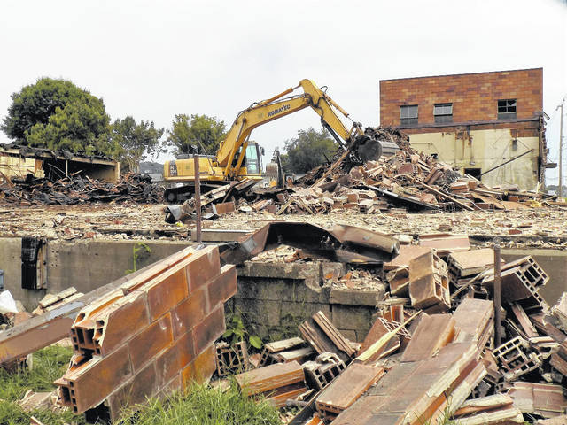 Work is ongoing on the library's warehouse demolition and site improvements project at Spruce Street and First Avenue in Gallipolis. Hutton Excavating of Gallipolis was awarded the bid for the project, and, pictured is demolition continuing on the project on Thursday.