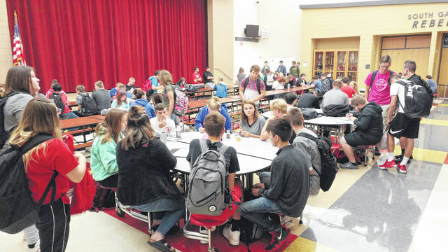 Students at South Gallia converse and eat before class.
