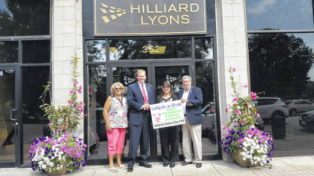 Gallipolis in Bloom recently declared Hilliard Lyons on Second Avenue in Gallipolis as having the Best Business Floral Display. From left to right are GIB member Bev Dunkle, Ryan Smith, Lori Young and Bryce Smith of Hilliard Lyons.