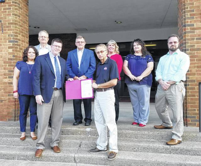 Gallia Commissioners and the Gallia Prosecutor's Office recognized September as Suicide Prevention Awareness Month. From left to right are Gallia Counselor Amy Sission, Gallia Commissioner Harold Montgomery, Gallia Prosecutor Jason Holdren, Gallia Commissioner Brent Saunders, Gallia Commissioner David Smith, Gallia Victim's Advocates Regina Brown and Christy Perkins, and Gallia Citizens for Prevention and Recovery Chair Thom Mollohan.