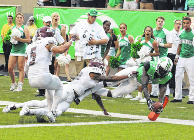 Marshall senior wideout Tyre Brady (8) stretches the ball inside the pylon and beyond the goal line for a first quarter touchdown on Saturday during a 32-16 victory over Eastern Kentucky in a non-conference gridiron contest at Joan C. Edwards Stadium in Huntington, W.Va.