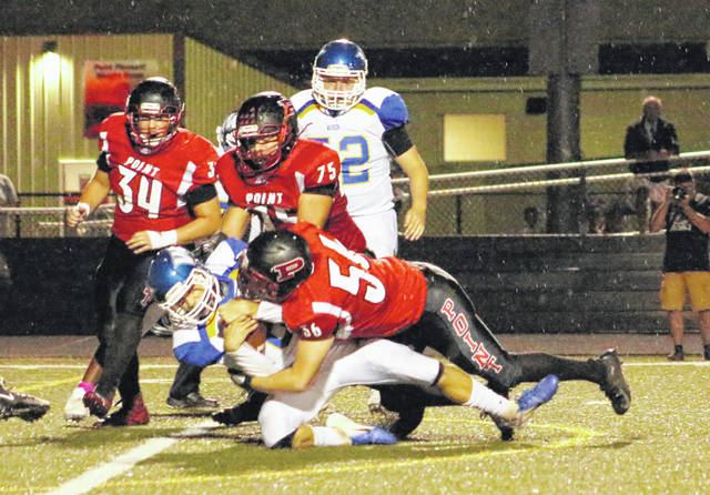 Point Pleasant defenders Eddie Mayes (56) and Ryan Duff (75) combine on a sack of Warren quarterback Kurt Taylor during the second quarter of Friday night's Week 3 football contest at OVB Field in Point Pleasant, W.Va.