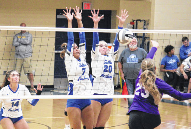Gallia Academy sophomore Maddy Petro (20) gets a block alongside teammate Peri Martin (7), during the Blue Angels' 3-0 sweep of Chesapeake on Tuesday in Centenary, Ohio.