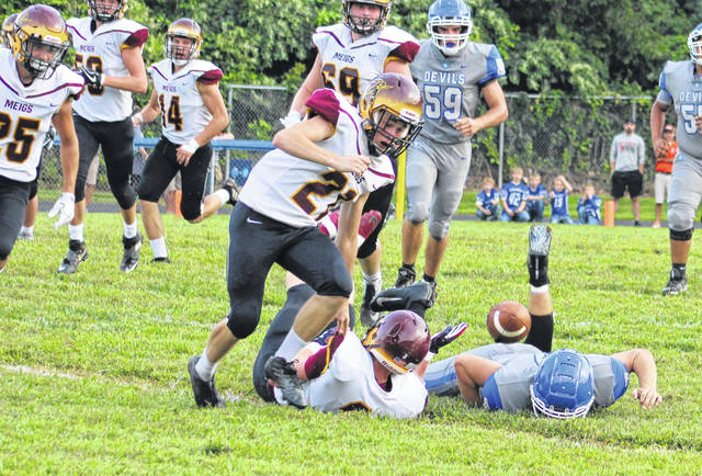 Meigs senior Wesley Smith (21) scrambles to recover a fumble during a Week 1 football contest against Gallia Academy at Memorial Field in Gallipolis, Ohio.