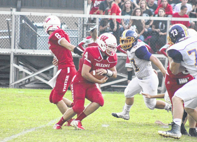 Wahama senior Brady Bumgarner (4) takes a handoff in the first quarter of the White Falcons' loss to Southern, in a Week 3 TVC Hocking game at Bachtel Stadium in Mason, W.Va.