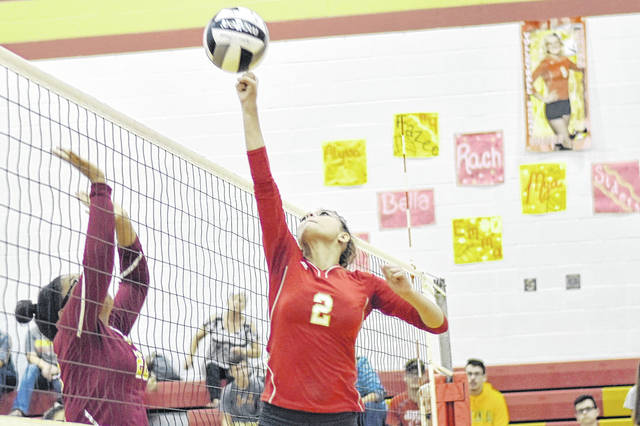 SGHS junior Amaya Howell (2) attempts to score over a Federal Hocking block attempt during the Lady Rebels victory over the Lady Lancers on Monday in Gallia County.