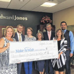 Edward Jones financial advisors and families donate to Make-A-Wish