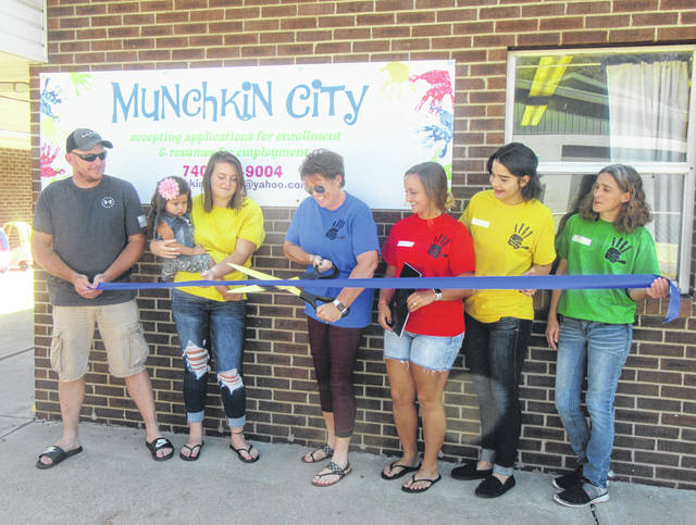 A ribbon cutting took place last week at Munchkin City Day Care in Middleport. Pictured are owners Serena and Josh Larsen, along with daughters Saelym and Anna, and Munchkin City employees Ashley Johnson, Jennifer Richards and Madison Hendricks.