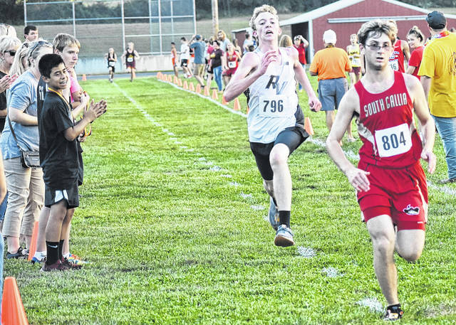 South Gallia's Griffin Davis (804) battles RVHS freshman Nathan Young down the stretch at the Federal Hocking Invitational on Wednesday in Stewart, Ohio.