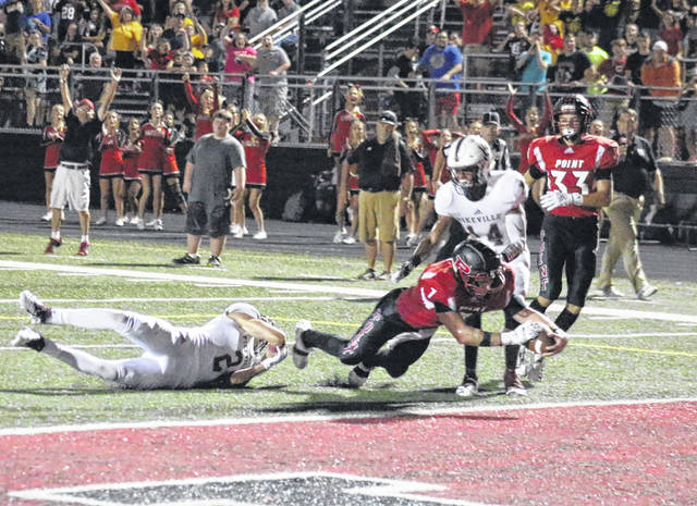 PPHS senior Cason Payne (7) dives across the goal line for the final touchdown of the Big Blacks' 41-34 victory on Friday in Point Pleasant, W.Va.