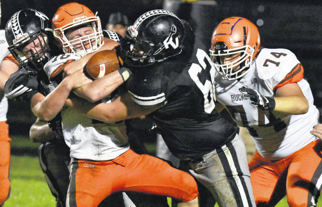 RVHS Jacob McGhee (62) makes an assisted tackle during the Raiders 54-28 setback to Nelsonville-York in a Week 4 TVC Ohio contest in Bidwell, Ohio.