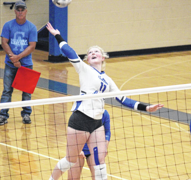 Gallia Academy senior Ashton Webb (11) goes up for a spike, during the Blue Angels' straight games victory over Portsmouth on Thursday in Centenary, Ohio.