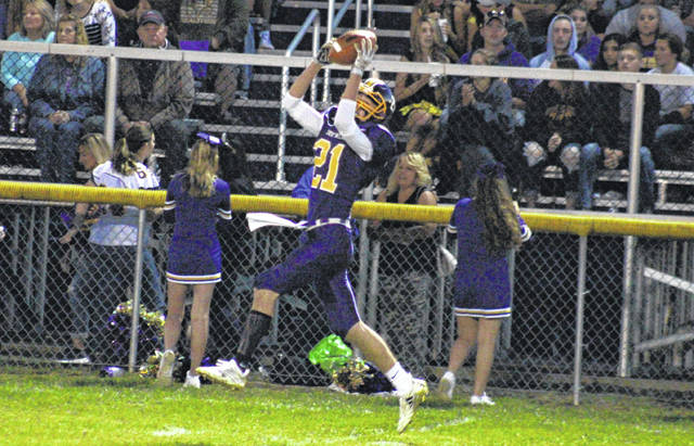 Southern senior Austin Baker (21) hauls in a pass along the home sideline, during the Tornadoes homecoming victory on Friday in Racine, Ohio.