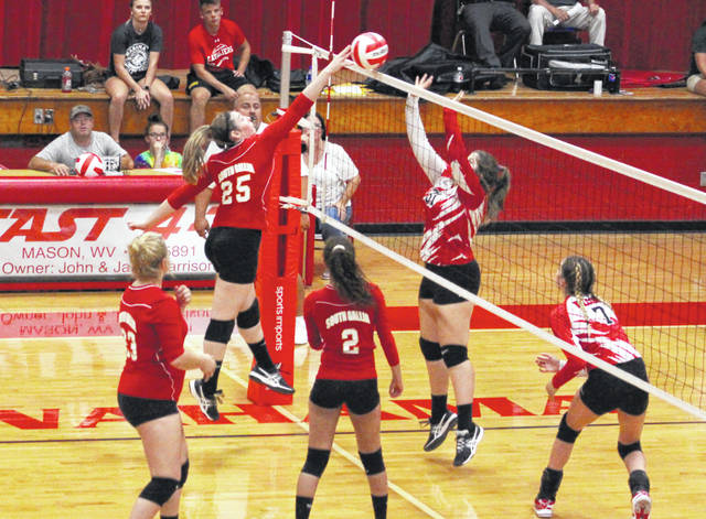 South Gallia junior Christine Griffith (25) hits a spike attempt over a Wahama blocker during Game 1 of Wednesday night's TVC Hocking volleyball contest at Gary Clark Court in Mason, W.Va.