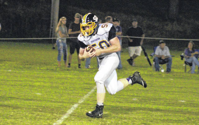 Southern senior Alex VanMeter returns a White Falcon fumble 40 yards for a touchdown, during the Tornadoes' 43-0 victory on Friday in Mason, W.Va.