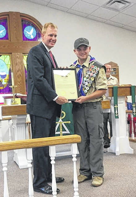 Ohio Speaker of the House Ryan Smith stands with newly named Eagle Scout Andrew Compston.