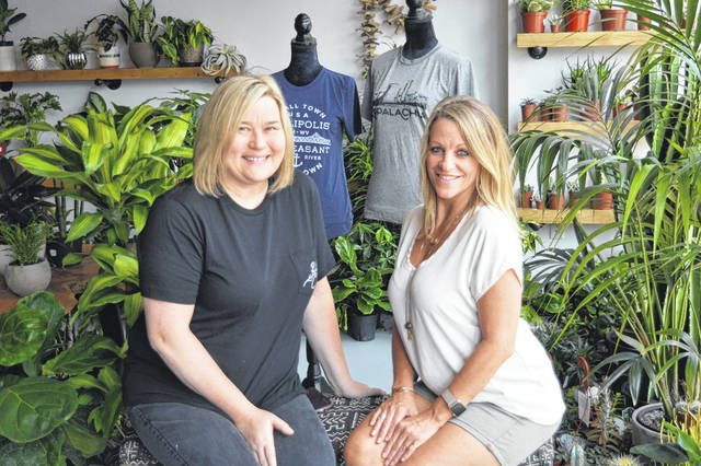 Elisha Biland, proprietor of Lucky Cat, and Lori Clary, proprietor of the Potted Edge, share a store front on Second Avenue. Wendy Canaday is not pictured but also serves as co-proprietor of the Potted Edge.