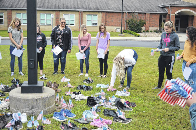 Students gather outside River Valley High School to remember the victims of the Sept. 11 terror attacks.