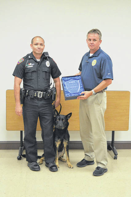 Pictured are Gallipolis Police Patrolman Mark Still, his canine partner Gina and Gallipolis Police Chief Jeff Boyer.