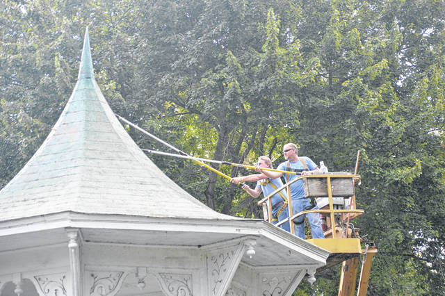 Contractors begin repairs to the bandstand roof.