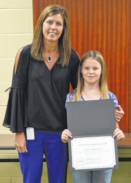From left to right, Vinton Elementary School Principal Leslie Henry stands with fourth grade student Jillian Hall. Hall scored a perfect score on the state math assessment test in spring of 2018. Gallia Local Schools Board of Education and Vinton Elementary School recognized her for her achievement at Monday's board meeting.