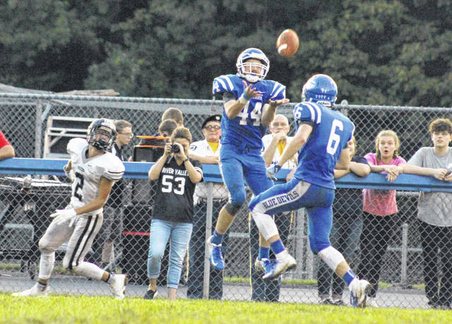 Gallia Academy senior Cole Davis (44) picks off a pass during a Week 2 football contest against River Valley at Memorial Field in Gallipolis, Ohio.