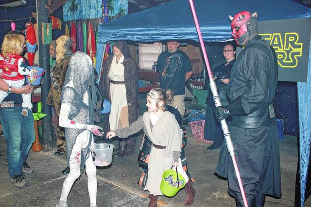 Jedi and Sith set aside their Star Wars animosity to hand out goodies during a past Holzer Health Center's Treat Street event.