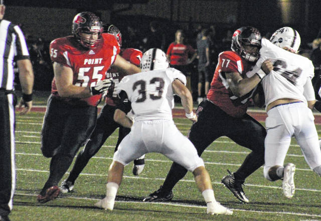 PPHS offensive linemen Jacob Muncy (55) and Trevon Franklin (77) provide a pair of blocks, during the Big Blacks' win over Pikeville on Sept. 21 in Point Pleasant, W.Va.