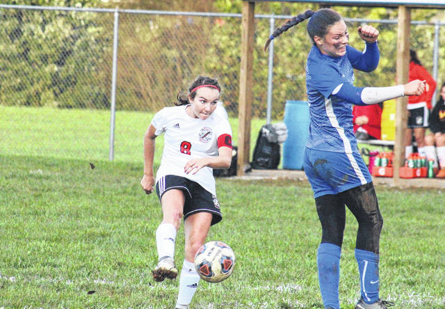 Point Pleasant senior Lexi Watkins-Lovejoy (8) attempts a shot in front of Gallia Academy freshman Preslee Reed (right), during the non-conference bout on Thursday at Lester Field in Centenary, Ohio.