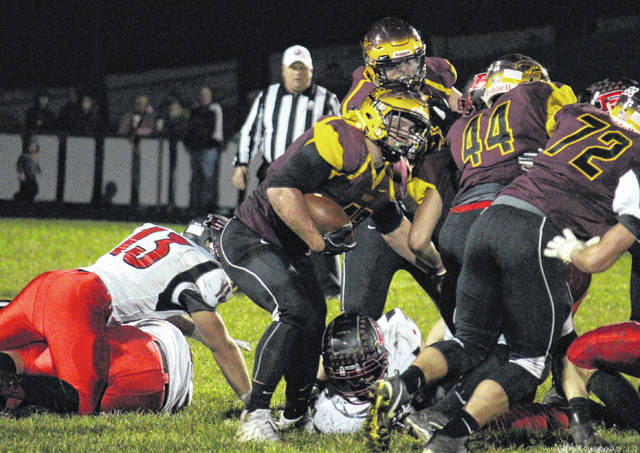 Meigs sophomore Abe Lundy (center) crosses the line of scrimmage behind blocks from Noah Metzger (44) and Andrew Dodson (72), during the Marauders' non-conference setback on Friday in Rocksprings, Ohio.