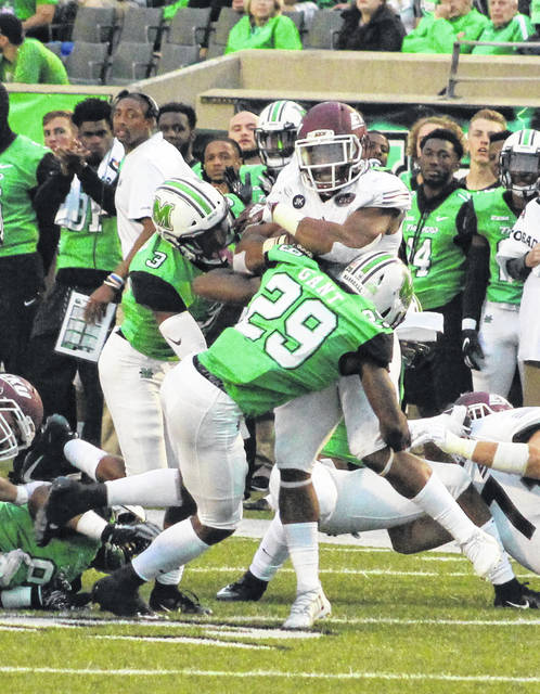 Marshall safety Malik Gant (29) makes a tackle on an Eastern Kentucky running back during the first half of a Sept. 8 contest at Joan C. Edwards Stadium in Huntington, W.Va.