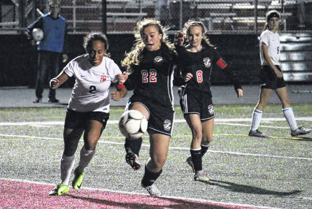 PPHS senior Bailey Thomas (22) kicks the ball in front of teammate Lexi Watkins-Lovejoy (8), during the Lady Knights' 6-0 victory on Monday in Point Pleasant, W.Va.