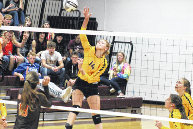 Meigs freshman Mallory Hawley (14) hits the ball over the net, during the Lady Marauders' home match against Nelsonville-York on Sept. 25 in Rocksprings, Ohio.