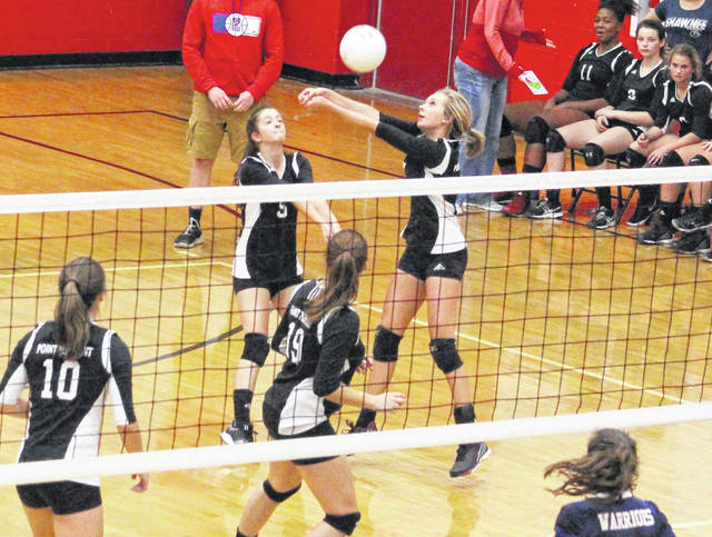 Point Pleasant senior Madison Hatfield, right, bumps a ball in the air during Game 1 of Tuesday night's volleyball match against Cross Lanes Christian in Point Pleasant, W.Va.