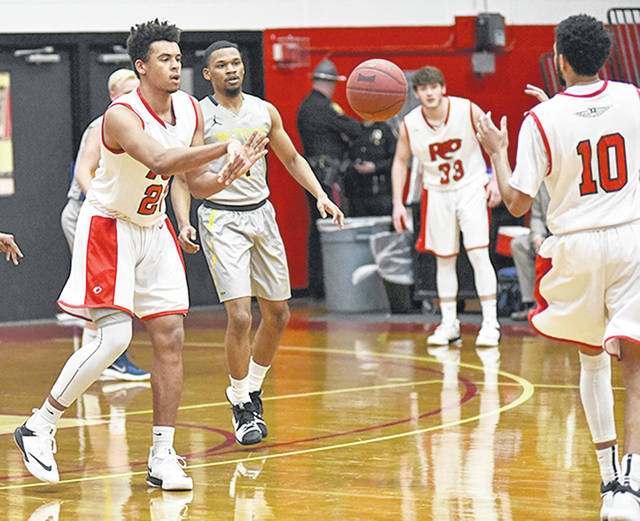 Rio Grande's Greg Wallace (making pass) and the rest of the RedStorm were picked sixth overall and third in the East Division of the River States Conference Men's Basketball preseason coaches' poll, which was released Tuesday by the league office.