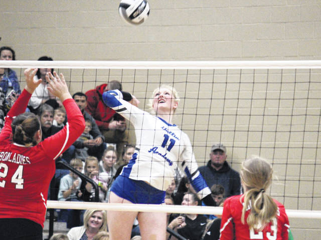 Gallia Academy senior Ashton Webb (11) goes up for a spike, during the Blue Angels' tournament-opening win over Jackson on Wednesday in Centenary, Ohio.