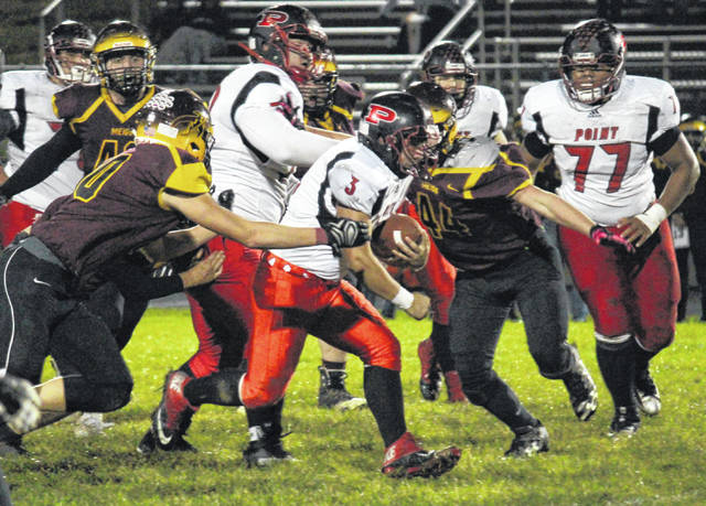 Point Pleasant senior Christian Holland (3) breaks tackles as he runs up the field, during the fourth quarter of the Big Blacks' 55-13 win on Oct. 12 in Rocksprings, Ohio.
