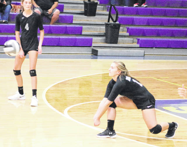 River Valley senior Jordan Garrison, right, receives a serve during Wednesday night's Division II sectional semifinal volleyball match against Unioto in Chillicothe, Ohio.