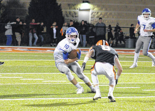 Gallia Academy senior Cory Call (10) jukes around an Ironton defender, during Friday's Ohio Valley Conference game in Ironton, Ohio.