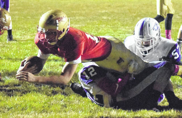 SGHS senior Gavin Bevan (17) dives into the end zone during the second quarter of the Rebels' 35-7 victory over Miller on Friday night in Mercerville, Ohio.