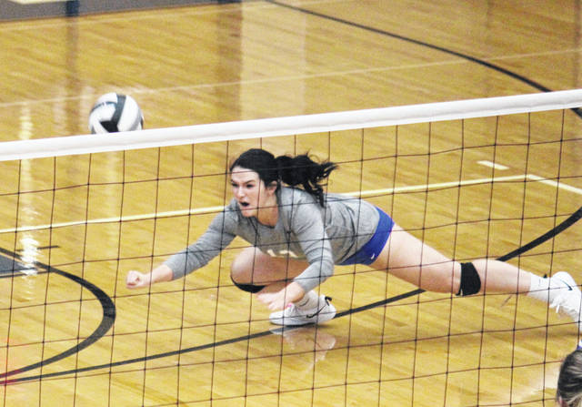 Gallia Academy senior Taylor Burnette dives for a dig, during the Blue Angels' sectional title victory on Saturday in Centenary, Ohio.
