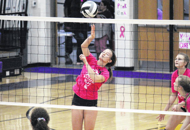 Southern junior Baylee Wolfe spikes the ball over the net, during the Lady Tornadoes' straight games win on Tuesday in Racine, Ohio.